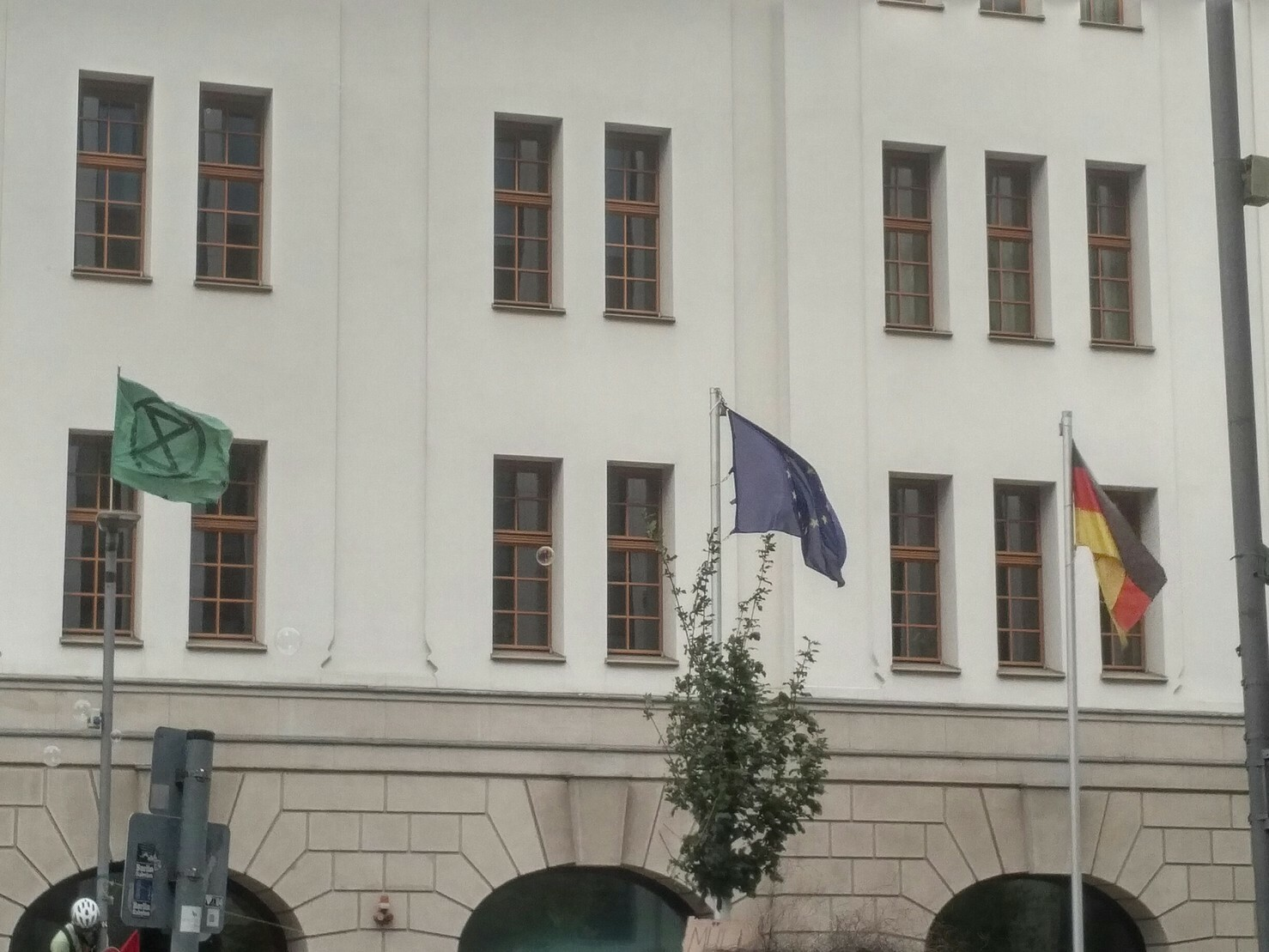 In front of German Ministry for Environment extinction rebellion flag has been raised next to european union and german